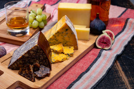 Irish brown porter cheese, blue cheese and tasting glass of single pot still whiskey from Ireland close up