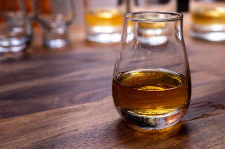 Scotch single malt or blended whiskey tasting on distillery in Scotland, UK, close up