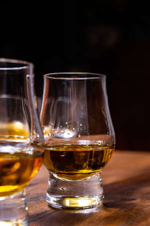 Scotch single malt or blended whiskey tasting on distillery in Scotland, UK, close up