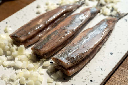 New season of Dutch herring fresh salted fish ready to eat, traditional food in Netherlands