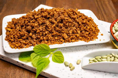Source of fiber plant based vegan soya protein minced meat, meat free healthy food close up