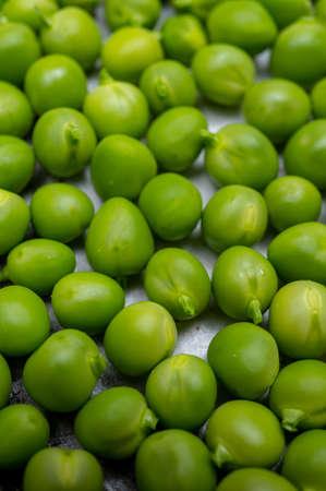 New harvest of fresh ripe green peas legumes
