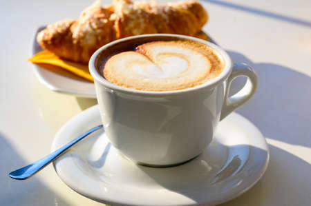 Breakfast coffee, Italian classic cappuccino with milk foam served in cafe close up 免版税图像