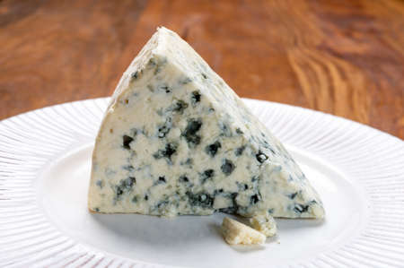 Cheese collection, piece of danish blue cheese with blue mold close up