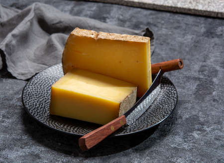 Cheese collection, French hard comte cheese made from cow milk in region Franche-Comte, France close up 写真素材