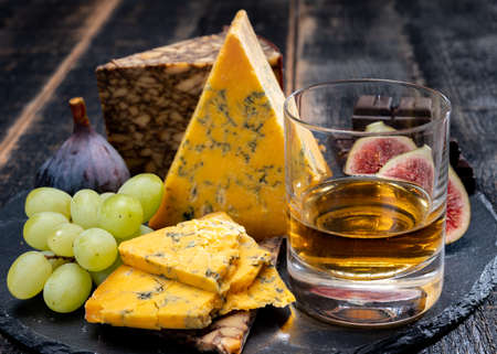 Tasting of Scotch single malt whiskey and British cheeses close up Stock Photo