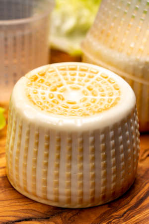 Cheese collection, italian soft smoked burrata cheese made from mozzarella with cream inside in region Apulia close up