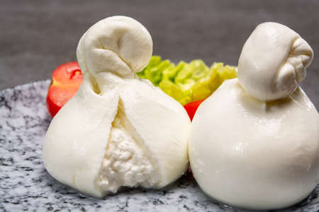 Cheese collection, italian soft white balls of burrata cheese made from mozzarella with cream inside in region Apulia close up 写真素材