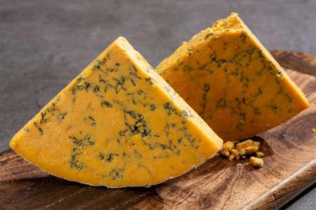 Cheese collection, English shropshire blue waxed cheese close up 版權商用圖片