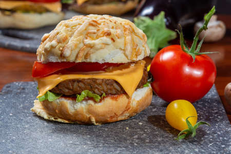 Healthy vegan or vegetarian fast food, fresh made plant based burgers with vegetables close up