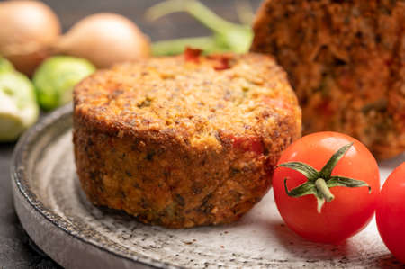 Fresh veggie burgers made from vegetables, beans and legumes, tasty vegan food close up
