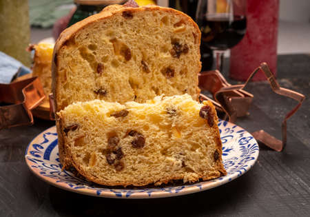 Christmas food, fresh Italian panettone cake made from yeast dough with dried fruits from Milan Archivio Fotografico