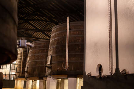 Old porto lodge with rows of concrete vats of fortified ruby or tawny porto wine in Vila Nova de Gaia, Portugal, north of Portugal