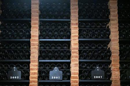 Bottles of vintage fortified ruby or tawny porto wine in old cellars of Vila Nova de Gaia, Portugal, north of Portugal