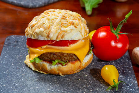 Healthy vegan or vegetarian fast food, fresh made plant based burgers with vegetables close up Reklamní fotografie