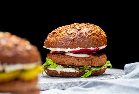 Vegan burgers with grilled healthy plant based, meat free burgers and fresh vegetables Reklamní fotografie