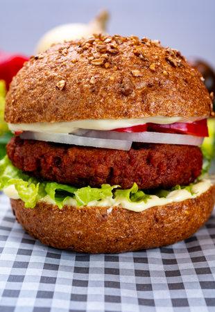 Tasty hamburger made from vegetarian plant based imitation minced meat burger and fresh vegetables Reklamní fotografie