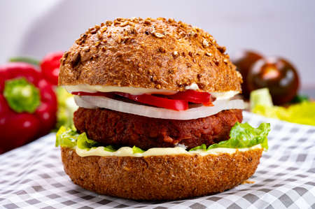 Tasty hamburger made from vegetarian plant based imitation minced meat burger and fresh vegetables