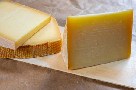 Cheese collection, French comte and Swiss gruyere cheeses close up