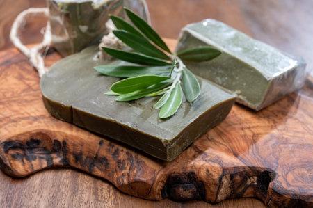 Green blocks of handmade bio vegetal natural olives and bay leaf soap from Provence, France