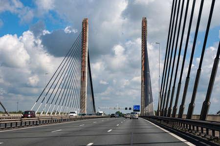 Road network infractrusture in Netherlands, driving safe on high quality asphalt on Dutch highways and briges. Foto de archivo