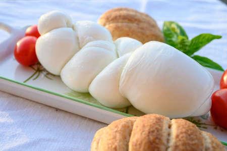 Fresh soft white italian cheese braid mozzarella buffalo made from Italian buffalo's milk by pasta filata method in Amaseno, Lazio, Italy