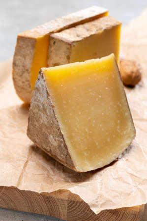 French cheese Comte, three varieties 1 year matured Prestige, fruity flavored Fruite and Vieille Reserve close up