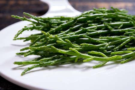 Tasty vegetarian sea food, fresh raw green salicornia or glasswort, pickleweed close up Stock Photo