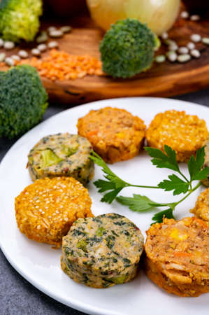 Small colorful tasty vegan and vegetarian burgers made from fresh vegetables and dried legumes and beans