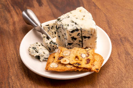 Cheese collection, piece of soft French blue cheese roquefort close up