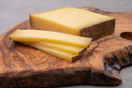Cheese collection, French cheese comte made from cow milk in the Franche-Comte region in France, close up