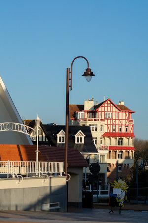April 25, 2021 De Haan or La Coq sur mer, Belgium, old belle epoque town in West Flanders on North Sea coast, luxury travel destination in sunny day Редакционное