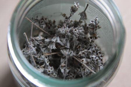 Sprigs of dried lavender in a jar