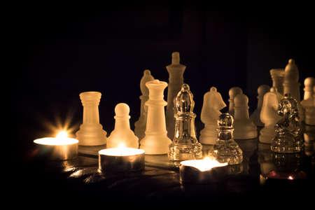 candlelit: Glass chess set lit by tea lights.