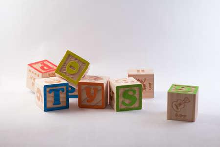 child s block: Toy alphabet blocks isolated on a white backdrop.