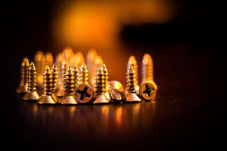 glows: Pile of screws with a warm glow.