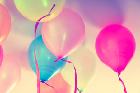 pink wall paper: Close up of colorful balloons - retro look