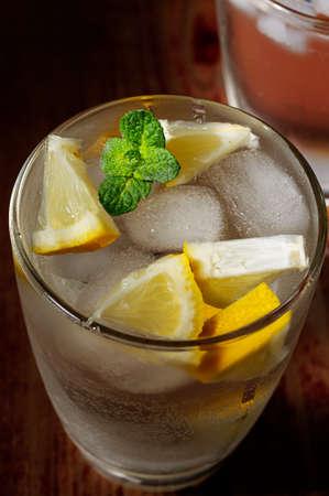 woden: Cold fresh lemonade on the woden table Stock Photo