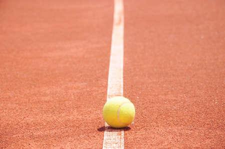 tennis clay: Tennis ball on a tennis clay court