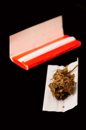 rolling paper: Marijuana and rolling paper on black background
