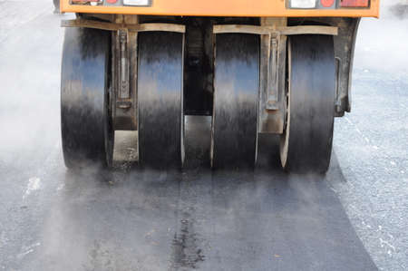 resurfacing: Heavy roller used during resurfacing of city street Stock Photo