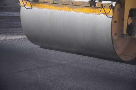 resurfacing: Heavy roller used during resurfacing of city street Stock Photo