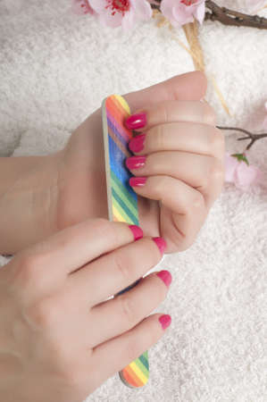 Manicure process in beauty salon photo