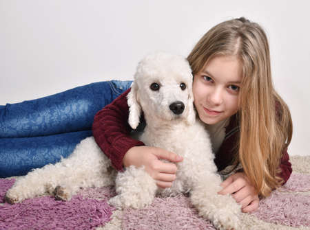 Litle girl and dog posing at home Stock Photo