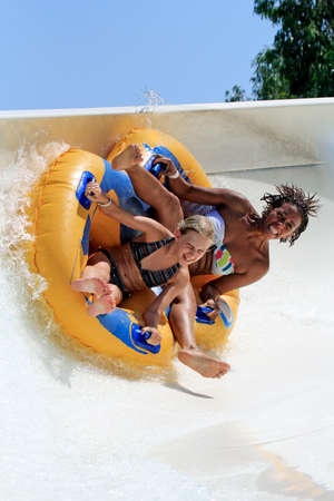 water pool: Faliraki,Rhodes, Greece-August 26,2015:Mom and daughter drive with tube on the rafting slide in the  Water park.Rafting slide is one of many popular game for adults and children in park.Water Water Park is located in Faliraki on the island of Rhodes in Gr