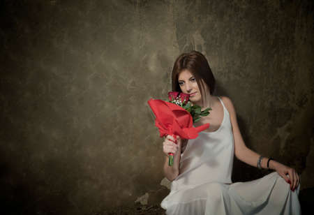 sexy glamour: Girl in white with roses in abandoned house Stock Photo