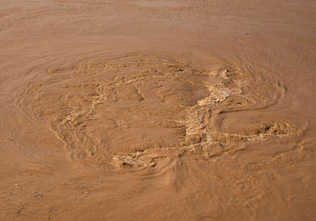 muddy: Muddy water flowing in the river after a rain storm