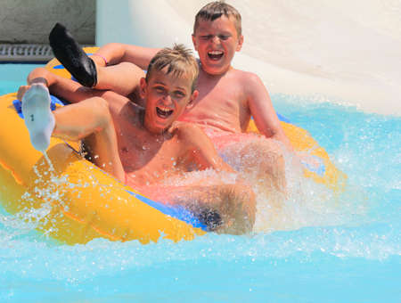 Rhodes, Greece-August 1,2016:The group of boys on the rafting slide in the  Water park.Rafting slide is one of many popular game for adults and children in park.Water Water Park is located on the island of Rhodes in Greece and one of the most largest in E
