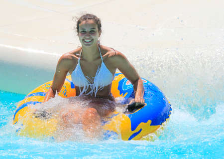 Rhodes, Greece-august 13 ,2016:The girl after rafting slide in the  Water park.Rafting slide is one of many popular game for adults and children in park.Water Water Park is located on the island of Rhodes in Greece and one of the most largest in Europe an Editorial
