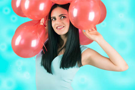 Beautiful girl with red balloons